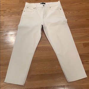 Ivory denim jeans with brown stitching